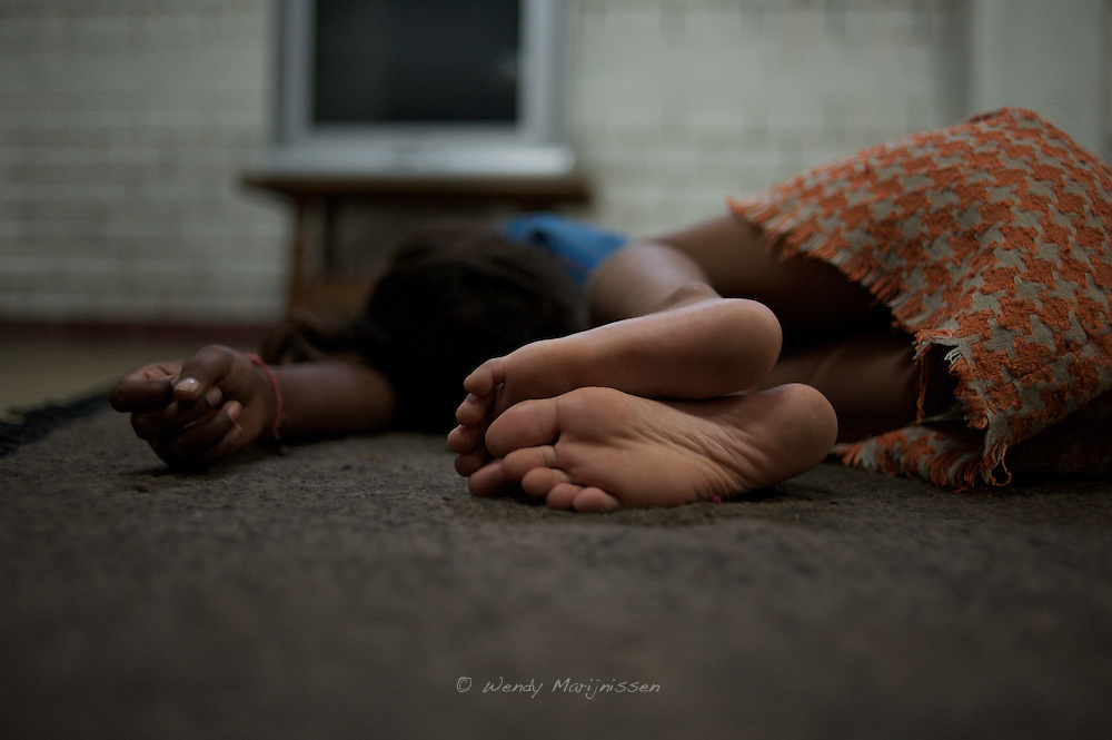 Two girls are sleeping after a day at school. Arushi shelter, New Delhi, India