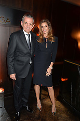 Stephen UrquhartT and CINDY CRAWFORD at the OMEGA VIP dinner hosted by Cindy Crawford and OMEGA President Mr. Stephen Urquhart held at aqua shard', Level 31, The Shard, 31 St Thomas Street, London, SE1 9RY on 10th December 2014.