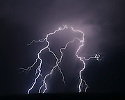 Cloud-to-ground lightning bolts at night with side forks to air, © 2015 David A. Ponton