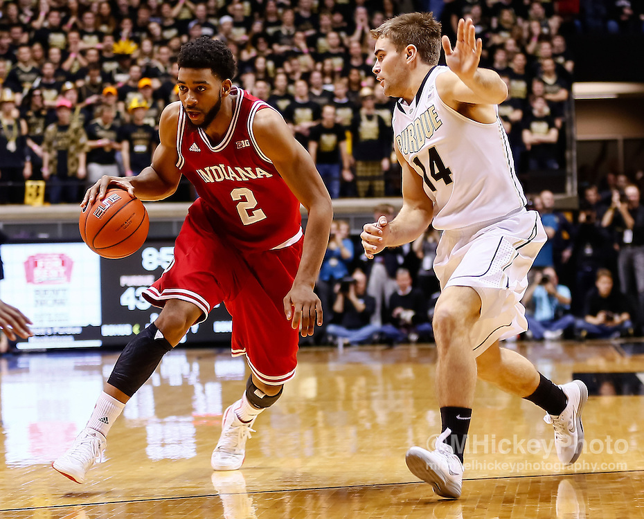 WEST LAFAYETTE, IN - JANUARY 30: Christian Watford #2 of the Indiana Hoosiers dribbles the ball against Dru Anthrop #14 of the Purdue Boilermakers at Mackey Arena on January 30, 2013 in West Lafayette, Indiana. Indiana defeated Purdue 97-60. (Photo by Michael Hickey/Getty Images) *** Local Caption *** Christian Watford; Dru Anthrop