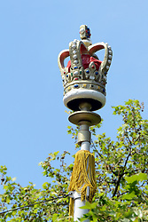 © Licensed to London News Pictures. 30/05/2012. London, UK A crown decoration on top of a lamppost in The Mall. A view along the Mall towards Buckingham Palace. Preparations today 20th May 2012 around London ahead of The Queen's Diamond Jubilee this weekend. Photo credit : Stephen Simpson/LNP