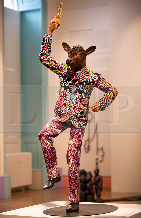 © Licensed to London News Pictures. 11/06/2019. London, UK. Yinka Shonibare's 'Revolution Kid (Calf, 2012)' is shown at the 'Get Up, Stand Up Now: Generations of Black Creative Pioneers' exhibition at Somerset House, London. This major new exhibition celebrates the past 50 years of Black creativity in Britain and beyond. Beginning with the radical Black filmmaker Horace Ové and his dynamic circle of Windrush generation creative peers and extending to today's brilliant young Black talent globally, a group of around 100 interdisciplinary artists are showcasing their work together for the first time, exploring Black experience and influence, from the post-war era to the present day. The exhibition opens on June 12, 2019 and runs until September 15, 2019.  Photo credit: Peter Macdiarmid/LNP