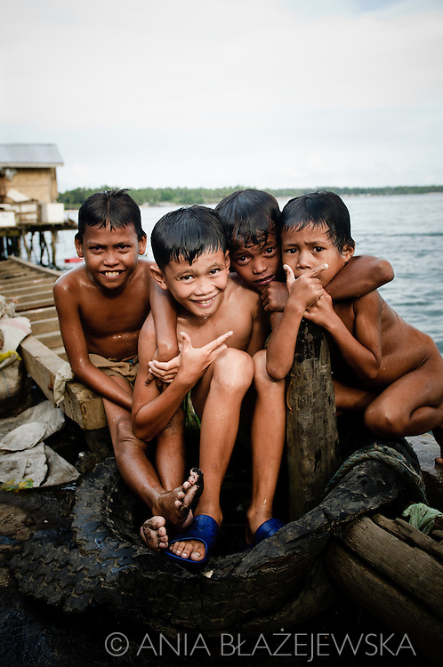 Philippines, Tawi Tawi. Four Filipino boys after a bath in port water of Bongao, the capital of the Philippines.