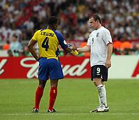 Photo: Chris Ratcliffe.<br /> <br /> England v Ecuador. 2nd Round, FIFA World Cup 2006. 25/06/2006.<br /> <br /> Wayne Rooney of England offers a drink to Ulysses De La Cruz of Ecuador.