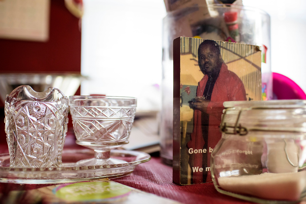 Washington, D.C. - March 29, 2017: A memorial photo of Charles &quot;Chuckie&quot; Craig sits on his mother Claudette Craig's kitchen table in her Washington DC home Wednesday March 29, 2017. She's lost two of her five children to gun violence. Charles &quot;Chuckie&quot; Craig, Kevin Durant's coach and mentor, was gunned down April 30th, 2005 in Laurel, Md., at the age of 35. Durant wears #35 as tribute to Craig.<br /> <br /> Her eldest, Ryan, a marine, was killed during a family visit to Georgia by a rival of his cousin when he was 20-years-old. <br /> <br /> NBA Superstar Kevin Durant's jersey number &quot;35&quot; is a tribute to his rec. league coach and mentor Charles &quot;Chuckie&quot; Craig, who was gunned down in at a night club in Laurel, Md., in 2005 when he was 35 years old. <br /> <br /> CREDIT: Matt Roth for The New York Times<br /> Assignment ID: 30204524A