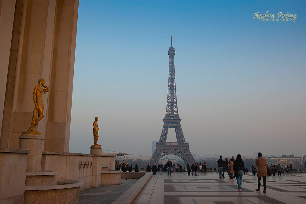 Visitors view the Eiffel Tower from the Esplanade du Trocadero