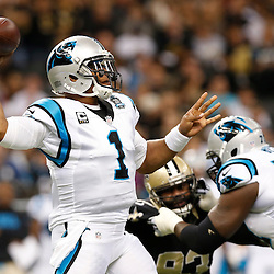 Dec 7, 2014; New Orleans, LA, USA; Carolina Panthers quarterback Cam Newton (1) passes against the New Orleans Saints during the first quarter of a game at the Mercedes-Benz Superdome. Mandatory Credit: Derick E. Hingle-USA TODAY Sports