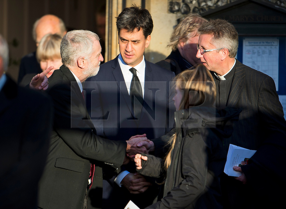 © Licensed to London News Pictures. 13/11/2015. London, UK. Current Labour party leader JEREMY CORBYN (left) and Former Labour party leader ED MILIBAND (centre) after The funeral of former Labour MP Michael Meacher at St Mary's Church in Wimbledon, south west London.  Michael Meacher, who was a Labour MP in Oldham for over 40 years, served as Minister of State for the Environment in the Tony Blair government.  Photo credit: Ben Cawthra/LNP