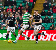 4th April 2018, Celtic Park, Glasgow, Scotland; Scottish Premier League football, Celtic versus Dundee; Mikael Lustig of Celtic and Kevin Holt of Dundee