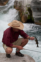 ANGLER WITH A SMALLMOUTH BASS DEVILS RIVER TEXAS