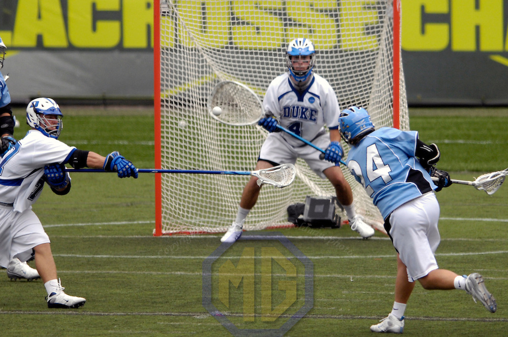 28 May 2007:  Duke University goalie Dan Loftus (4) stops a 2nd quarter shot by Johns Hopkins attacker Kevin Huntle (24) in the NCAA Division I Lacrosse Championship game.  The Johns Hopkins Blue Jays defeated the Duke Blue Devils 12-11 to win the NCAA Division I Lacrosse championship at M&T Bank Stadium in Baltimore, Md. .