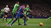 Wilfred Zaha tries to break past Ryan Bertrand during the Barclays Premier League match between Crystal Palace and Southampton at Selhurst Park, London, England on 12 December 2015. Photo by Michael Hulf.