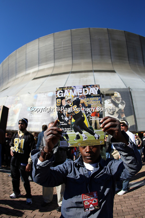 NEW ORLEANS - DECEMBER 07: A vendor holds up a game program outside the stadium before the New Orleans Saints game against the Atlanta Falcons at the Louisiana Superdome on December 7, 2008 in New Orleans, Louisiana. The Saints defeated the Falcons 29-25. ©Paul Anthony Spinelli