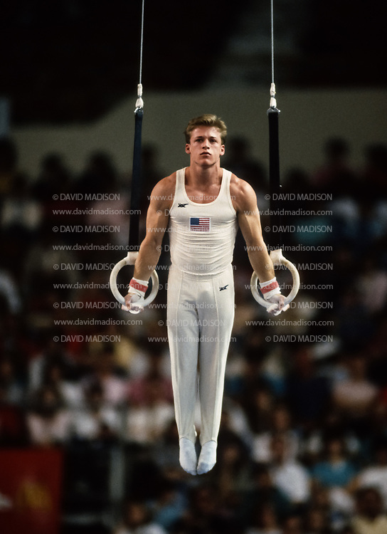 PHOENIX - APRIL 24:  Mike Chaplin of the United States competes on the still rings during a USA - USSR gymnastics meet on April 24, 1988  at the Arizona Veterans Memorial Coliseum in Phoenix, Arizona.  (Photo by David Madison/Getty Images)