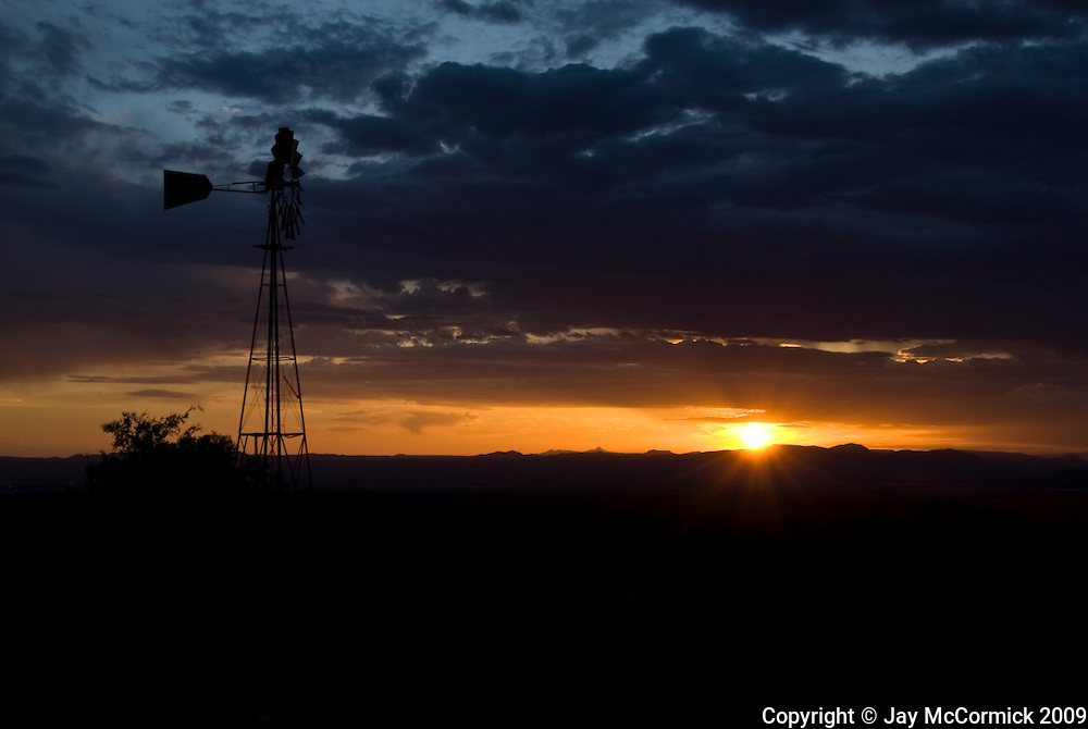 Windmill on ranch in Baylor Canyon, just NW of Las Cruces, NM.  Shot at late sunset