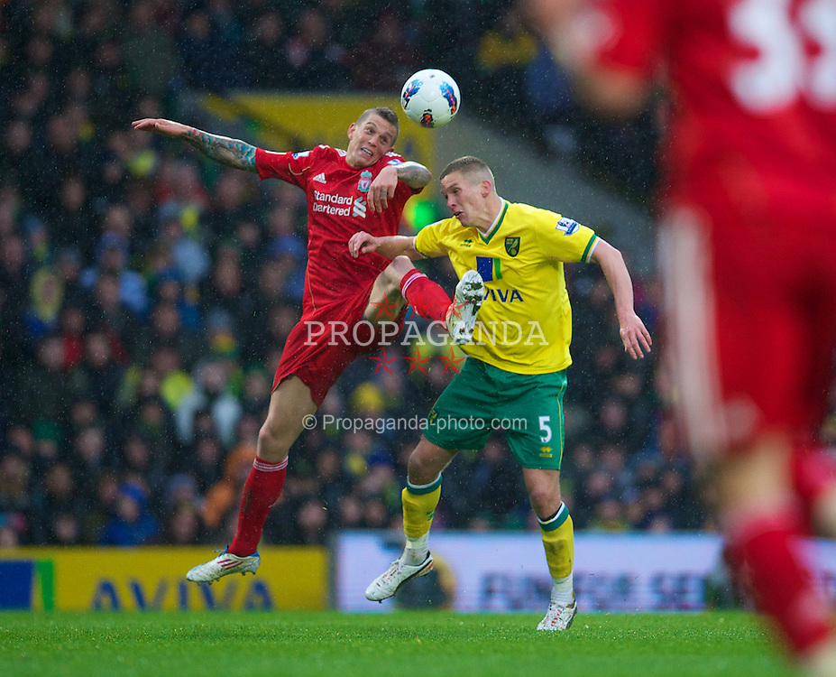 NORWICH, ENGLAND - Saturday, April 28, 2012: Liverpool's Daniel Agger in action against Norwich City's Steve Morison during the Premiership match at Carrow Road. (Pic by David Rawcliffe/Propaganda)