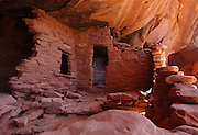 "The remains of an Anasazi dwelling are tucked under a cliff near Bullfrog, Utah. The Anasazi, also referred to as ""the Ancient Ones""  are a culture that lived in the southwestern United States around 1200 B.C. to 1300 A.D."