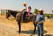 Henry Real Bird, grandchildren Hank and Emma, Crow Fair, Montana, horse