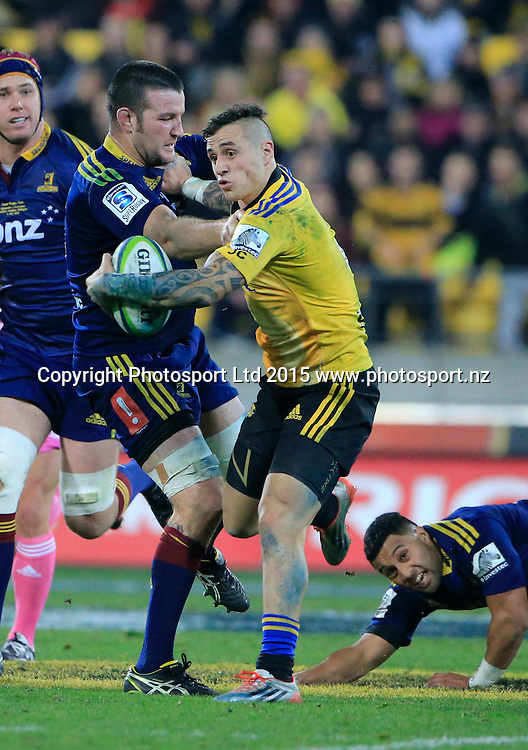 Hurricanes TJ Perenara breaks a tackle.  Super Rugby Final, Hurricanes v Highlanders. Westpac Stadium, Wellington, New Zealand. 4 July 2015. Copyright Photo: John Cowpland / www.photosport.nz