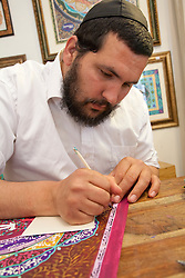 Middle East, Zafed, artist insribing Hebrew prayer on painting.  MR