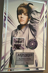 "Justin Bieber will be honored by his Canadian hometown with the launch of a new museum exhibition featuring memorabilia from his past. The Stratford Perth Museum, located in southwestern Ontario, promises a ""behind the scenes look"" at the 23-year-old singer's meteoric rise to success. Visitors will be able to see a wide array of artifacts provided by Bieber and his relatives, as well as other Stratford residents who have connections with him. The collection includes dozens of pieces from his music career, such as Grammy awards, Teen Choice Awards, a personal letter from former First Lady Michelle Obama and clothing he wore during major concert performances. It will also feature personal items from his childhood in Stratford, including a hockey jacket he wore when he played for the Stratford Warriors Peewee Travel Team as well as photos and videos. No stone has been left unturned as even Bieber's old sneakers have made the cut and feature in the exhibition. The exhibit, which opens on February 18, is called ""Steps to Stardom,"" in reference to the steps of Stratford's Avon Theatre where Bieber used to sing and play his guitar as a young busker. A video posted to YouTube of him performing on those steps garnered millions of views and ultimately helped him land his first recording contract as a 13-year-old wannabe star. John Kastner, General Manager of the Stratford Perth Museum, said: ""We're very excited about this exhibit and helping to share a fascinating story about a hometown hero who's gone on to remarkable achievements. ""We're grateful to Justin and his family for supporting what we wanted to do and allowing us to share a piece of their lives with the world."" The museum, which typically receives approximately 7,000 visits per year, is expecting the exhibit to generate significant interest among Bieber's following of dedicated fans across North America and around the world. ""The single biggest question we get from visitors at the muse"