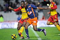 FOOTBALL - FRENCH CHAMPIONSHIP 2010/2011 - L1 - MONTPELLIER HSC v RC LENS - 19/03/2011 - PHOTO SYLVAIN THOMAS / DPPI - HENRI BEDIMO N'SAME (RCL) / JOHN UTAKA (MON)