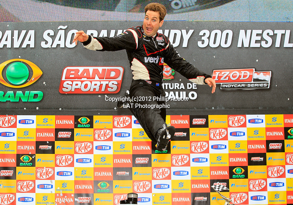 28-29 April, 2012, Sao Paulo, Brazil<br /> Will Power jumps for joy after winning in Brazil.<br /> (c)2012, Phillip Abbott<br /> LAT Photo USA