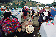 Preparing graveyard for Day of the Dead. Todos Santo de Cuchumatan, Guatemala.