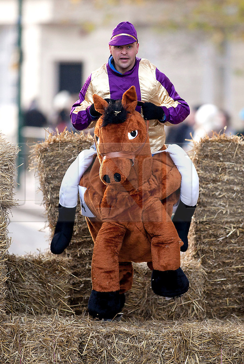 © under licence to London News Pictures 28/11/2010 today picture. Birmingham`s wackiest Christmas event, the annual Pantominme Horse Grand National. The event that sees riders and horses race up and down Broad Street in the City Centre jumping over and even Through straw bales. Pictures shows one of the riders going over the fences..Picture credit: Dave Warren/London News Pictures...