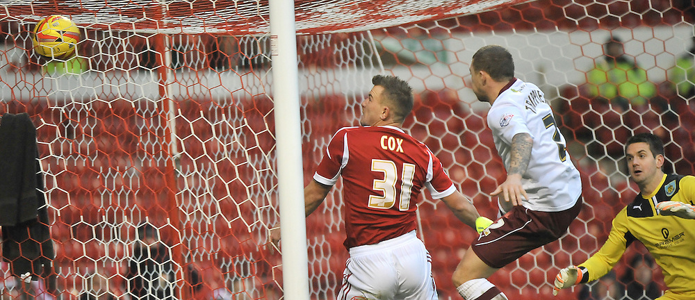 Simon Cox (Nottingham Forest FC) scoring during the Nottingham Forest FC V Burnley FC Skybet Championship game held on the 23rd November 2013 at the City Ground, Nottingham, UK.