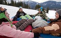 Girls tubing at Whistler-Blackcomb Tube Park, Whistler, BC Canada