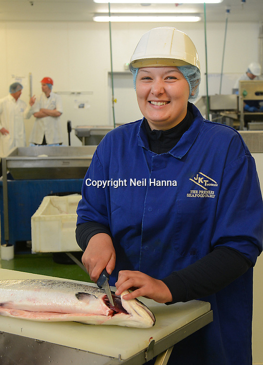 Scottish Apprenticeship Week 19-23 May 2014<br /> <br /> Seafood Apprentice Kirsty Peacock, 20, has been identified as the 3,000th person to complete a Scottish Modern Apprenticeship. She works for family seafood processing firm JK Thomson of Musselburgh, near Edinburgh<br /> Kirsty has completed  a Modern Apprenticeship L2 in  Fish & Shellfish Processing skills.  She is one of a number  (33 candidates have achieved a modern apprenticeships along with 2 trained and qualified assessors  with a further 29 currently working towards level 2MA and 2 L3 first in Scotland to be working towards level 2  MA and and 2 L3 first in Scotland to be working towards the new Level 3 in Fish and Shellfish industry skills.  <br /> Pictured:<br />  Kirsty Peacock, 3000th Food & Drink Manufacturing Modern Apprentice