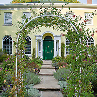 A distinctive historic yellow house with exquisite gardens in Toronto's Forest Hill.