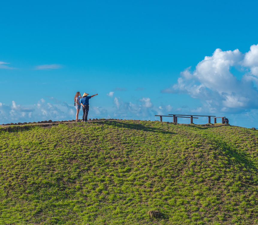 Easter Island, Chile -- March 31, 2018. Two women at the top of a hill; one is pointing into the distance. Editorial use only.