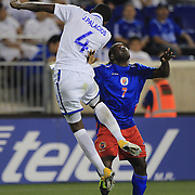 Jeff Louis, Haiti, (right),  is challenged by Johnny Palacios, Honduras, during the Haiti V Honduras CONCACAF Gold Cup group B football match at Red Bull Arena, Harrison, New Jersey. USA. 8th July 2013. Photo Tim Clayton