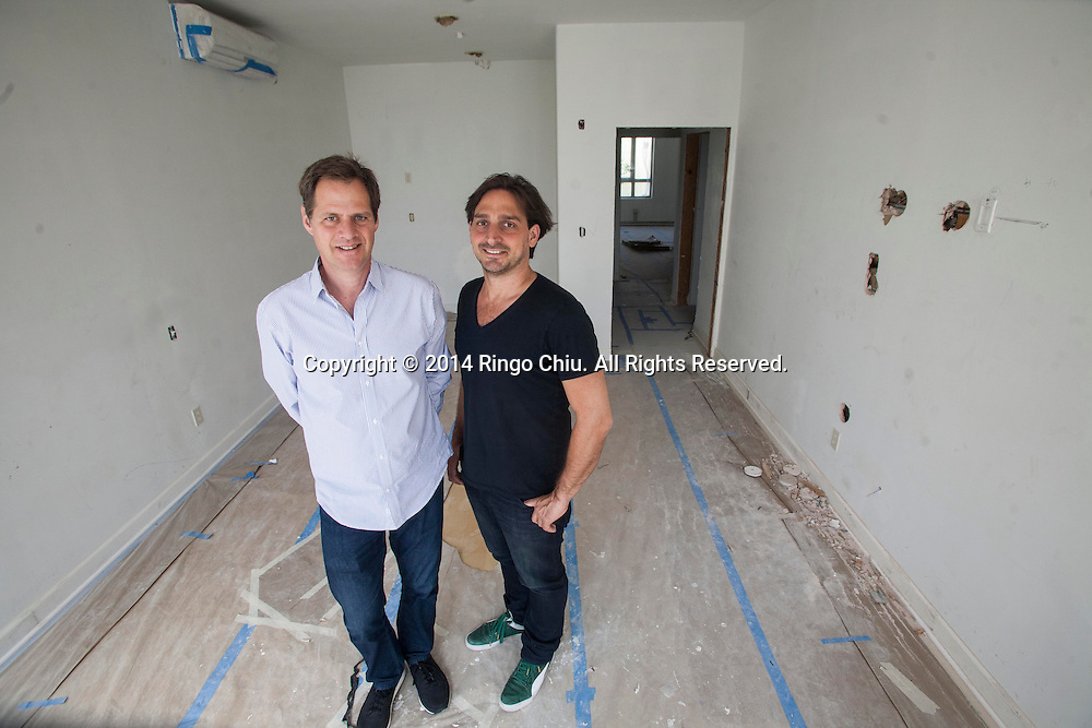 Chef Juan Pablo Torre, right, and David Green, parters of hospitality group Tuck Ventures that's turning an old downtown building into Dart Hotel & Restaurant in downtown Los Angeles. (Photo by Ringo Chiu/PHOTOFORMULA.com)