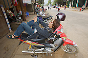 Tam Duong market. Man having a nap on his motorbike.