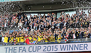 Arsenal players celebrate during the The FA Cup match between Arsenal and Aston Villa at Wembley Stadium, London, England on 30 May 2015. Photo by Phil Duncan.
