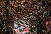Followed by thousands of attendees, a giant TV screen magnifies the movements of a cowboy fighting a bull for a millionaire prize during the Barretos Rodeo Fair in  Sao Paulo state, Brazil, Thursday, Aug. 23, 2012. Brazil is on a quick path to become a global power. Rising economy, big infrastructure projects, an emerging and eager consuming middle class and the booming national industry are the evidences and consequences of the wealth in the southern nation. But the often hidden source of all this wealth falls far from the luring Rio beaches or the Kolkata-New York mix that Sao Paulo is. Behind texan hats and a similar attitude the countrymen display their power through a myriad of projects, festivals and behavior visually analyzed here.