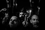 Protesters in Cairo's Tahrir Square watch with disbelief and anger on a TV screen Egyptian President Hosni Mubarak announcing he will not step down. 10 February 2011.