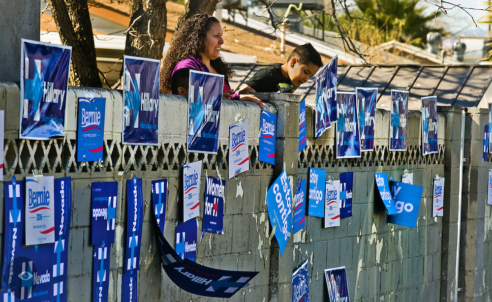Neighborhood residents look over their backyard wall at the Democratic Caucus event at Rancho High School on Saturday, February 20, 2016. L.E. Baskow