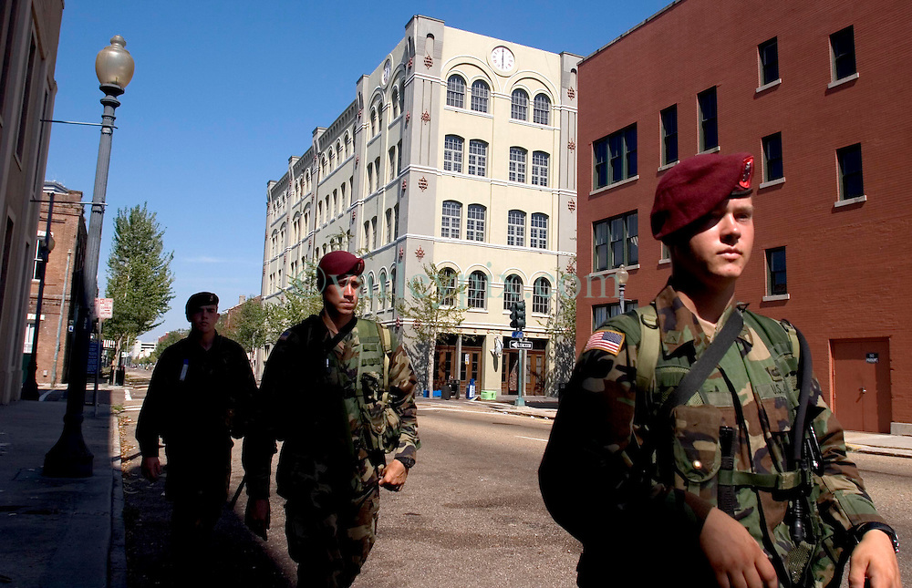 08 Sept 2005. New Orleans, Louisiana.  Hurricane Katrina aftermath.<br /> Members of the 82nd Airborne Regiment patrol the streets of the Central Business District to prevent any further looting and to secure the area.<br /> Photo; &copy;Charlie Varley/varleypix.com