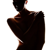 Nude woman on white backdrop