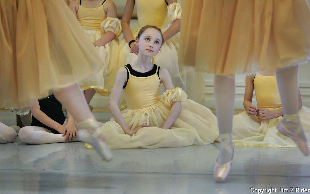 Chloe Benham, 9, watches rehearsal for Swan Lake at the Colfax Cultural Center in South Bend, Indiana.  She is a ribbon dancer.