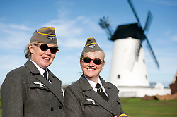 reenactors dressed as German army female signals auxiliaries (Nachrichtenheflrennin des heeres) also nicknamed Blitzmädchen or lightening girls because of the signals insignia on their uniforms, Pictured beside Lytham Windmill<br /> during the Lytham Saint Annes wartime weekend <br /> Saturday 18th August 2012<br /> Image © Paul David Drabble