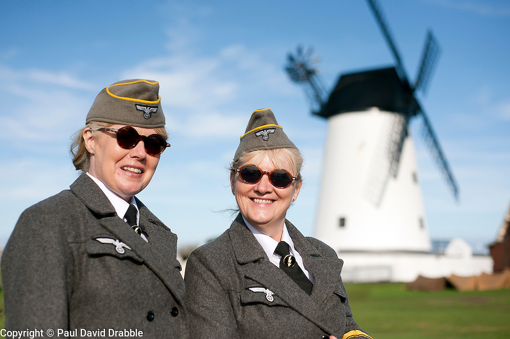 reenactors dressed as German army female signals auxiliaries (Nachrichtenheflrennin des heeres) also nicknamed Blitzm&auml;dchen or lightening girls because of the signals insignia on their uniforms, Pictured beside Lytham Windmill<br />