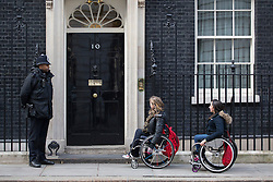 © licensed to London News Pictures. London, UK 27/02/2013. GB double gold medalist Hannah Cockroft (centre) and a wheelchair racer Charlotte Moore (right) in Downing Street to promote 'Get Inspired' manifesto for a Paralympic legacy and improvement of opportunities for disabled people. Photo credit: Tolga Akmen/LNP