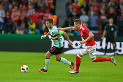 LILLE, FRANCE - Friday, July 1, 2016: Wales' Chris Gunter in action against Belgium's Eden Hazard during the UEFA Euro 2016 Championship Quarter-Final match at the Stade Pierre Mauroy. (Pic by Paul Greenwood/Propaganda)