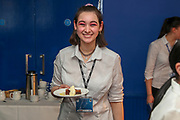 Waitress holding food during the EFL Sky Bet League 1 match between AFC Wimbledon and Bristol Rovers at the Cherry Red Records Stadium, Kingston, England on 19 April 2019.