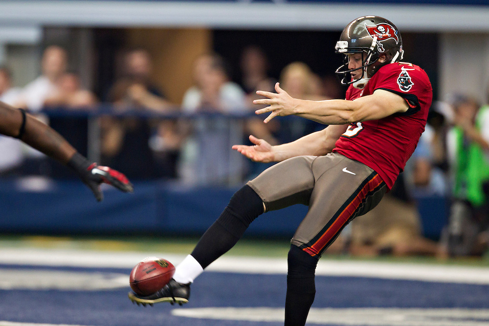 DALLAS, TX - SEPTEMBER 23:  Michael Koenen #9 of the Tampa Bay Buccaneers punts the ball against the Dallas Cowboys at Cowboys Stadium on September 23, 2012 in Dallas, Texas.  The Cowboys defeated the Buccaneers 16-10.  (Photo by Wesley Hitt/Getty Images) *** Local Caption *** Michael Koenen